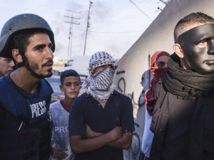 VICE correspondent Ahmed Shihab-Eldin speaks with Palestinian protestors in Ramallah, West Bank. Photo credit: Jackson Fager for VICE on HBO.