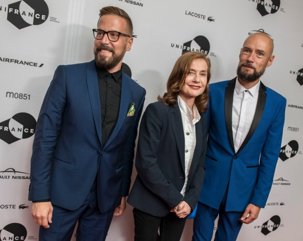 Producer Yves Verbracken, Actress Isabelle Hupert and Director Bavo Defurne of Souvenir on the red carpet at a party hosted by Unifrance to honour French films at the 2016 Toronto International Film Festival Sept. 10, 2016.
